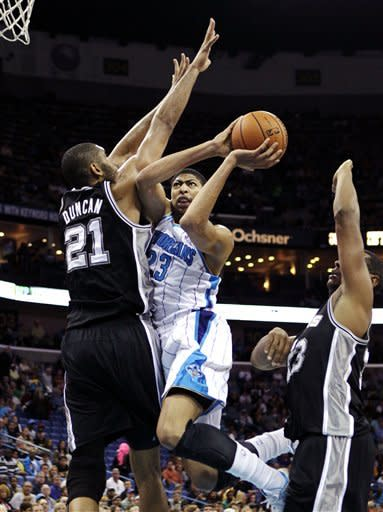 New Orleans Hornets power forward Anthony Davis (23) drives to the basket against San Antonio Spurs power forward Tim Duncan (21) in the first half of an NBA basketball game in New Orleans, Wednesday, Oct. 31, 2012. (AP Photo/Gerald Herbert)