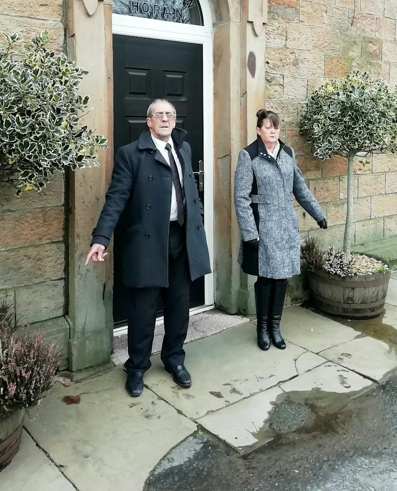 Ann Bentley & John Harpur outside the funeral home. (SWNS)