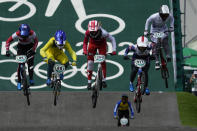 From left to right in foreground, Sae Hatakeyama of Japan, Saya Sakakibara of Australia, Zoe Claessens of Switzerland, Bethany Shriever of Britain, and Vineta Petersone of Latvia, are followed by Chutikan Kitwanitsathian of Thailand during a BMX Racing training session at the 2020 Summer Olympics, Wednesday, July 28, 2021, in Tokyo, Japan. (AP Photo/Ben Curtis)
