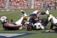 Auburn running back Sean Jackson (44) stretches over the goal line for a touchdown as Alabama State lineman Joshua Long (98) defends during the second half of an NCAA football game Saturday, Sept. 11, 2021, in Auburn, Ala. (AP Photo/Butch Dill)