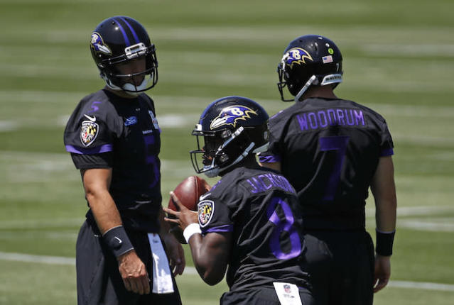 Baltimore Ravens quarterback Lamar Jackson, center, runs a drill in front of quarterbacks Joe Flacco, back left, and Josh Woodrum during an NFL football organized team activity at the team's headquarters in Owings Mills, Md., Thursday, May 24, 2018. (AP Photo/Patrick Semansky)