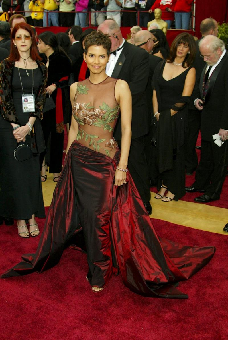 This Elie Saab dress shouldn't work: it's sheer with floralsand an oxblood twist which falls on Halle Berry's hips. But somehow it is magnificent. Is it the power of the dress or Berry herself? There's no point in asking: it just works.