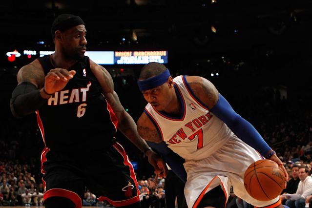 NEW YORK, NY - MAY 06: Carmelo Anthony #7 of the New York Knicks drives against LeBron James #6 of the Miami Heat in the first quarter of Game Four of the Eastern Conference Quarterfinals in the 2012 NBA Playoffs on May 6, 2012 at Madison Square Garden in New York City. NOTE TO USER: User expressly acknowledges and agrees that, by downloading and or using this photograph, User is consenting to the terms and conditions of the Getty Images License Agreement (Photo by Jeff Zelevansky/Getty Images)