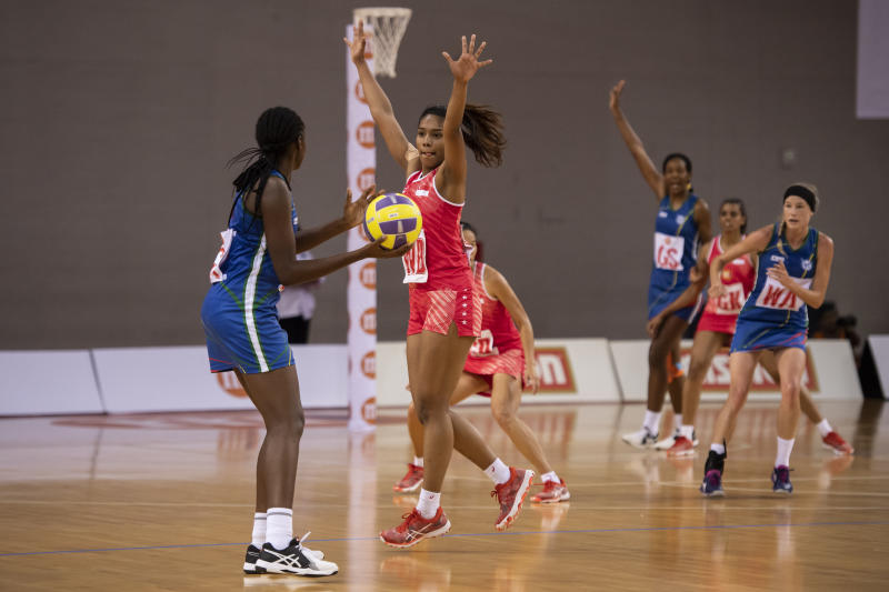 Singapore's wing defence Aqilah Andin blocks the passing lane of the Namibia players during the Netball Nations Cup final at the OCBC Arena. (PHOTO: Netball Singapore)