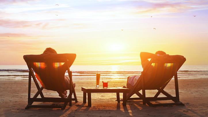 Couple on Beach with Cocktails