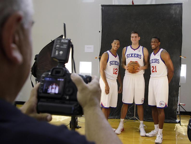 Philadelphia 76ers players from left, Evan Turner, Spencer Hawes and Thaddeus Young pose for a photographer during NBA basketball media day at the team's practice facility, Friday, Sept. 27, 2013, in Philadelphia. (AP Photo/Matt Slocum)