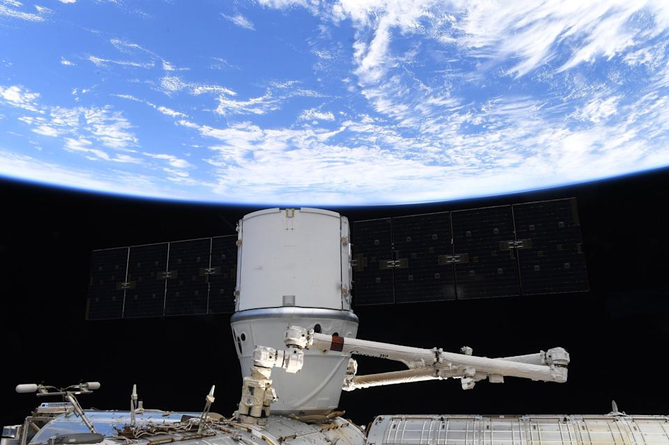SpaceX's last Dragon cargo ship to be captured by a robotic arm is parked at the International Space Station's Harmony module on March 9, 2020.