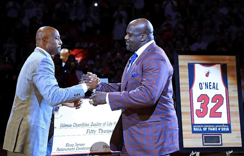 901df56c7403 Shaquille O  39 Neal (R) is honored by former teammate Alonzo Mourning