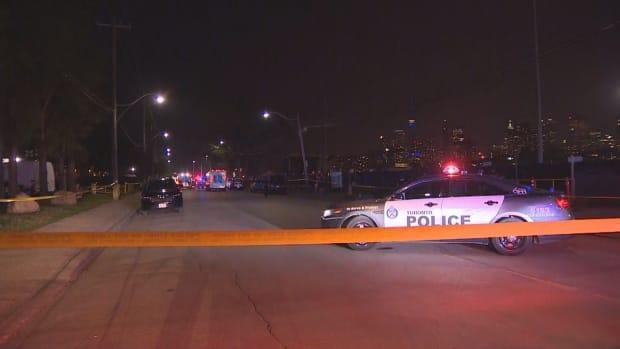 Toronto police have taped off a road after a fatal hit and run on Monday night. A man is dead and another person is injured. (CBC - image credit)