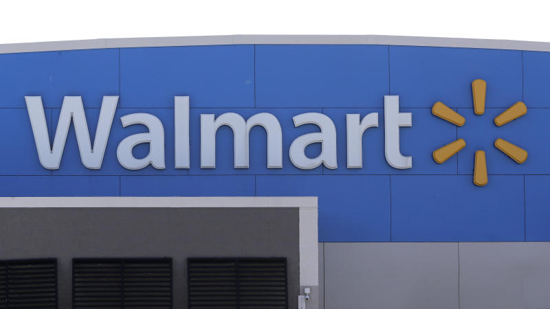 FILE - In this Sept. 3, 2019 file photo, a Walmart logo is displayed outside of a Walmart store, in Walpole, Mass. Walmart says it will stop selling electronic cigarettes at its namesake stores and Sam's Clubs following a string of illnesses and deaths related to vaping.  The nation's largest retailer said Friday, Sept. 20 that it will complete its exit from e-cigarettes after selling through current inventory. It cited growing federal, state and local regulatory complexity regarding vaping products. (AP Photo/Steven Senne, File)