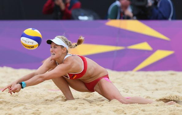 LONDON, ENGLAND - JULY 31: Sara Goller  of Germany dives for a shot during the Women's Beach Volleyball Preliminary match between Brazil and Germany on Day 4 at Horse Guards Parade on July 31, 2012 in London, England.  (Photo by Ryan Pierse/Getty Images)