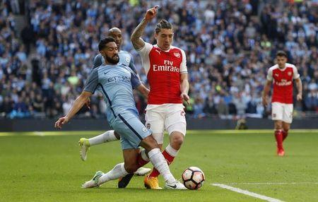 Arsenal's Hector Bellerin in action with Manchester City's Gael Clichy