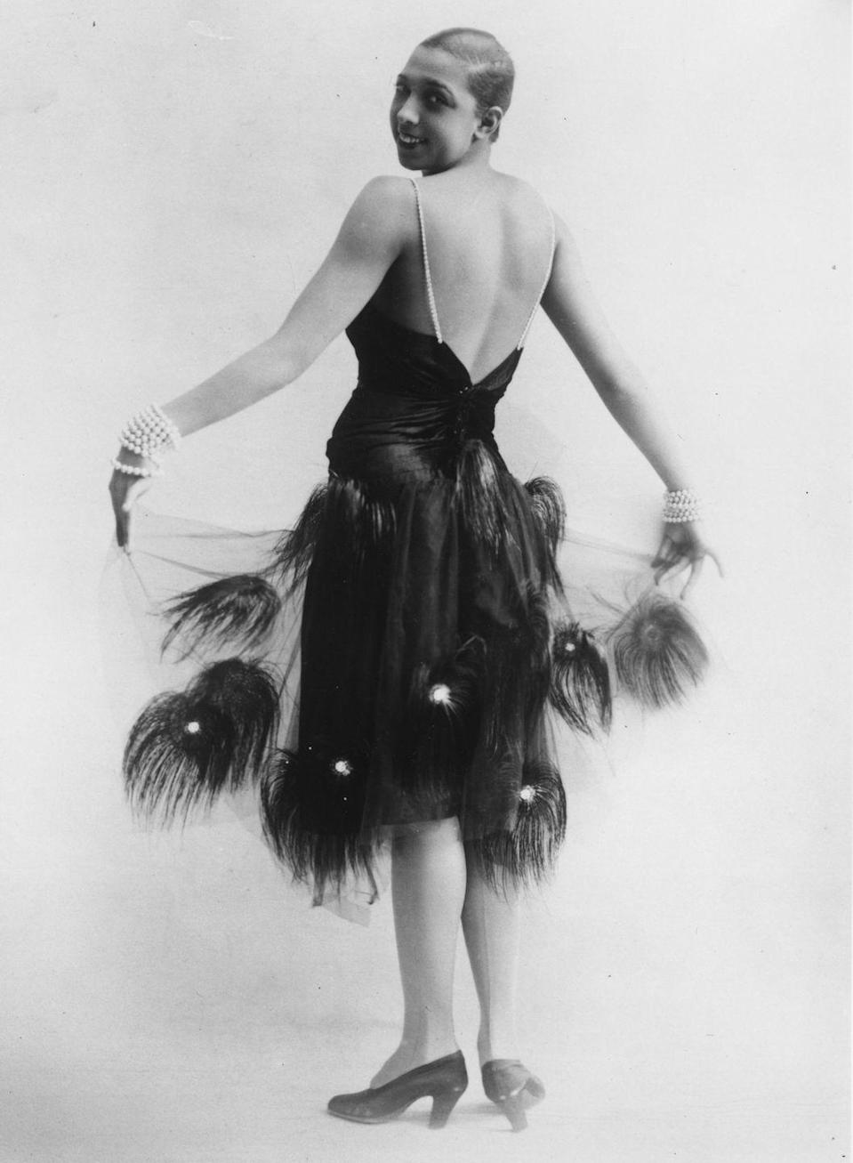 <p>Baker was a multi-talented performer: she could sing and dance and even acted in several motion pictures. Here, she stops for a photograph in another tulle-and-feathers creation. <br></p>