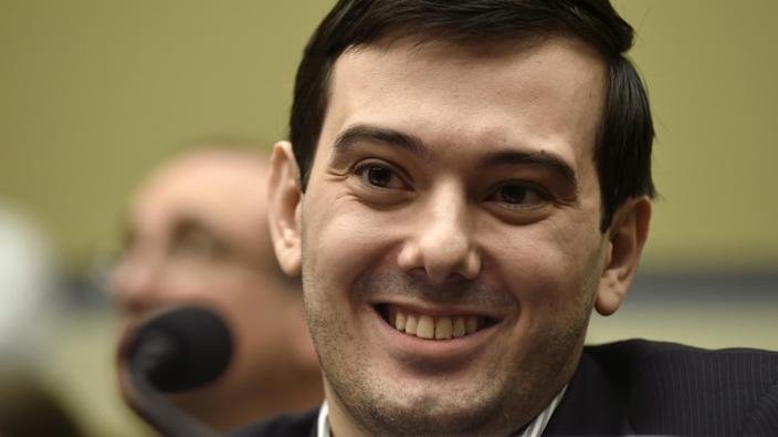 Pharma exec Martin Shkreli smiles on Capitol Hill during a 2016 hearing before the House Committee on Oversight and Reform