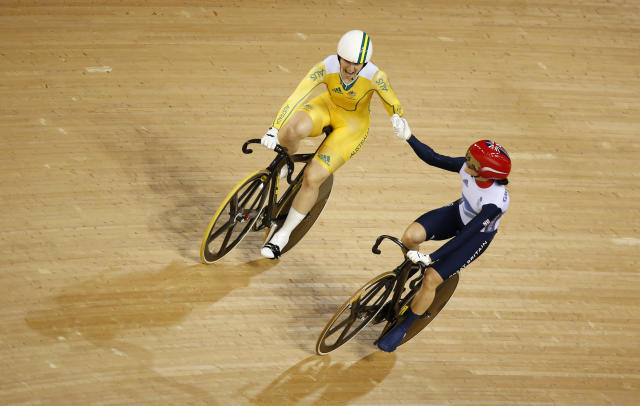 Australia's Anna Meares (in yellow) shakes hands with Britain's Victoria Pendleton after their track cycling women's sprint finals at the Velodrome during the London 2012 Olympic Games August 7, 2012. Meares won the gold medal. REUTERS/Paul Hanna (BRITAIN - Tags: OLYMPICS SPORT CYCLING)