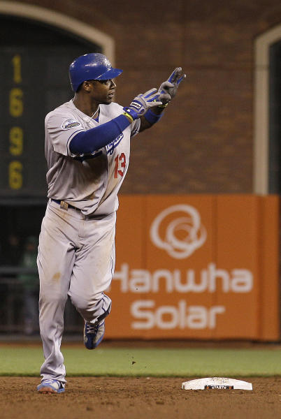 Los Angeles Dodgers' Hanley Ramirez (13) gestures as he rounds the bases after hitting a two-run home run off of San Francisco Giants pitcher Sergio Romo in the 10th inning of a baseball game in San Francisco, Friday, July 27, 2012. (AP Photo/Jeff Chiu)