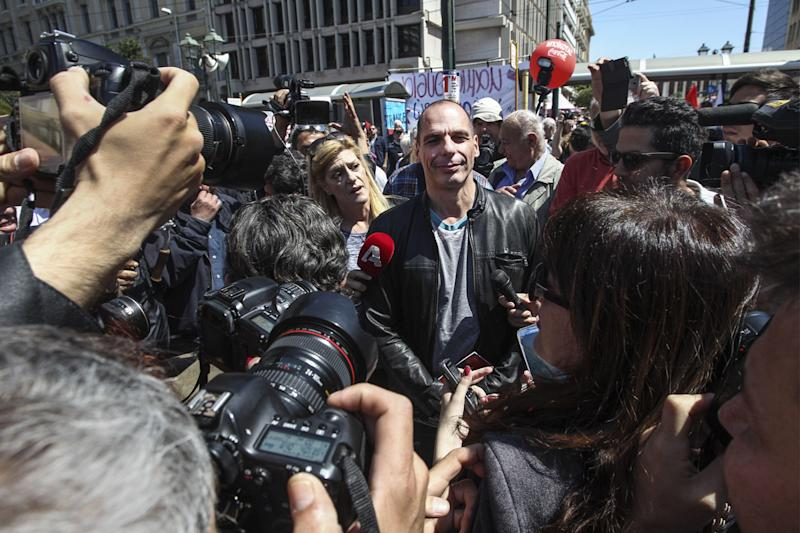 Political pin-up: Yanis Varoufakis at a rally in Athens during his short tenure as finance minister in 2015: Rex Features