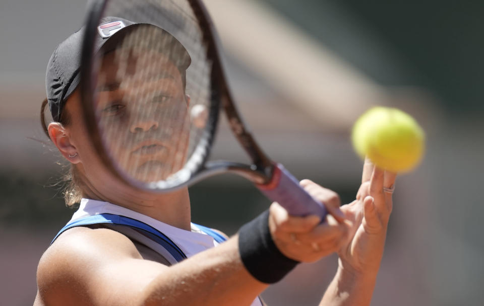 Australia's Ashleigh Barty plays a return to United States's Bernarda Pera during their first round match on day three of the French Open tennis tournament at Roland Garros in Paris, France, Tuesday, June 1, 2021. (AP Photo/Christophe Ena)