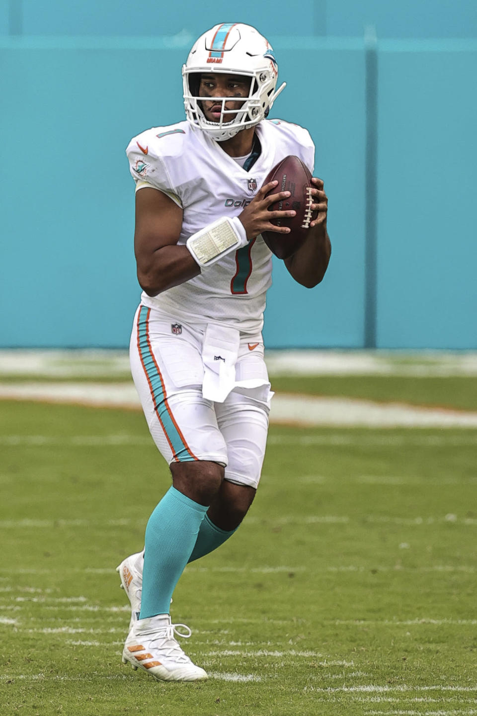 Miami Dolphins quarterback Tua Tagovailoa (1) looks downfield for a receiver in an NFL game against the Los Angeles Rams, Sunday, Nov. 1, 2020 in Miami Gardens, Fla. The Dolphins defeated the Rams 28-17. (Margaret Bowles via AP)