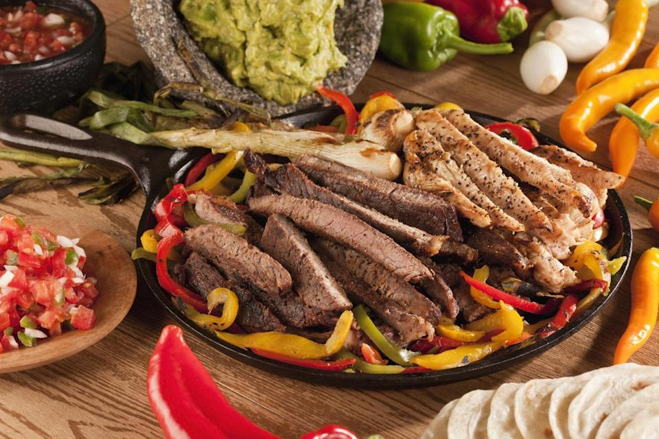 """<p>Turn your <a href=""""https://www.thedailymeal.com/cook/how-to-make-cheap-steak-tender-delicious?referrer=yahoo&category=beauty_food&include_utm=1&utm_medium=referral&utm_source=yahoo&utm_campaign=feed"""" rel=""""nofollow noopener"""" target=""""_blank"""" data-ylk=""""slk:cheap skirt steak"""" class=""""link rapid-noclick-resp"""">cheap skirt steak</a> into <a href=""""https://www.thedailymeal.com/eat/best-high-end-steakhouse-chains?referrer=yahoo&category=beauty_food&include_utm=1&utm_medium=referral&utm_source=yahoo&utm_campaign=feed"""" rel=""""nofollow noopener"""" target=""""_blank"""" data-ylk=""""slk:high-end steakhouse"""" class=""""link rapid-noclick-resp"""">high-end steakhouse</a> level fajitas. First, chop yours up into strips. Then, roll into tortillas and top with pico de gallo, guac or sour cream. </p> <p><strong><a href=""""https://www.thedailymeal.com/recipes/sizzling-steak-fajitas?referrer=yahoo&category=beauty_food&include_utm=1&utm_medium=referral&utm_source=yahoo&utm_campaign=feed"""" rel=""""nofollow noopener"""" target=""""_blank"""" data-ylk=""""slk:For the Steak Fajitas recipe, click here."""" class=""""link rapid-noclick-resp"""">For the Steak Fajitas recipe, click here.</a></strong></p>"""