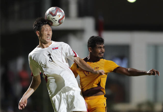 North Korea's Kuk Chol, left, heads the ball as Sri Lanka's Mohamad Fazal attempts to take the ball during the World Cup Group H Asia qualifying soccer match between Sri Lanka and North Korea in Colombo, Sri Lanka, Tuesday, Sept. 10, 2019. North Korea defeated Sri Lanka by 1-0. (AP Photo/Eranga Jayawardena)