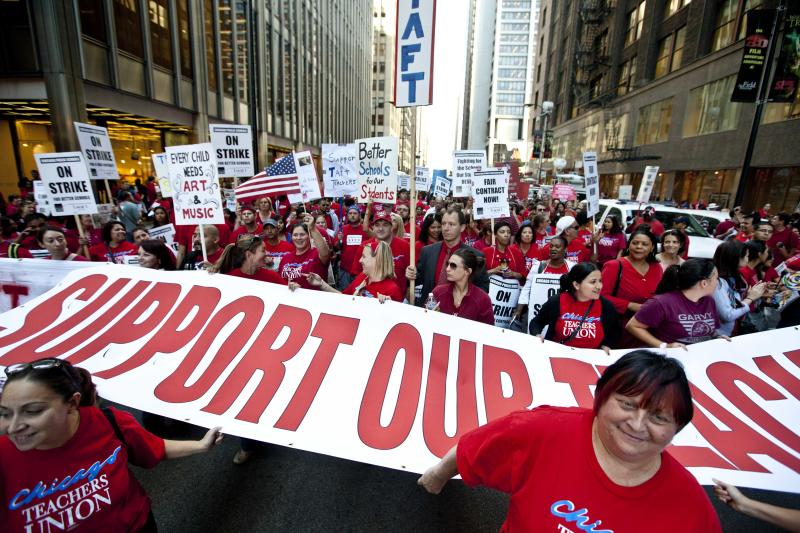 Thousands of public school teachers rally outside Chicago Public Schools district headquarters on the first day of strike action over teachers' contracts on Monday, Sept. 10, 2012 in Chicago. For the first time in a quarter century, Chicago teachers walked out of the classroom Monday, taking a bitter contract dispute over evaluations and job security to the streets of the nation's third-largest city — and to a national audience — less than a week after most schools opened for fall. (AP Photo/Sitthixay Ditthavong)