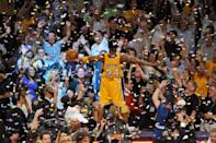 Kobe Bryant basked in the Staples Center glory of his fifth NBA championship after defeating the rival Boston Celtics in Game 7 of the 2010 Finals, vindicating the Lakers' title loss two years earlier. He earned his second straight Finals MVP honor. (Garrett Ellwood/NBAE via Getty Images)