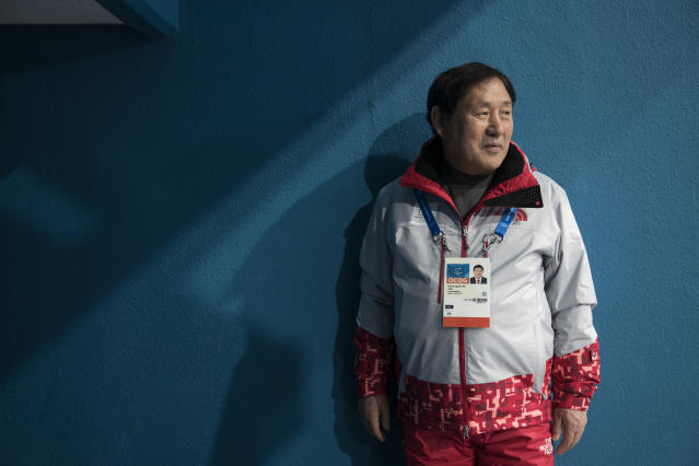 Lee Gyeong Pil waits for spectators to arrive at one the entrances of the Gangneung Curling center at the 2018 Winter Olympics in Gangneung, South Korea, Saturday, Feb. 24, 2018. Lee was among five babies born on an American ship that ferried thousands of Korean refugees from North Korea during the Korean War. Nicknamed by U.S. crew as Kimchi 1 through Kimchi 5, theyve become a symbol of the South Korea-U.S. military alliance. Lee, Kimchi 5, and his friend Sohn Yang Young, Kimchi 1, were in Gangneung to volunteer for the Olympics as part of their efforts to promote peace and remind younger generations of the lessons of the Korean War. (AP Photo/Felipe Dana)