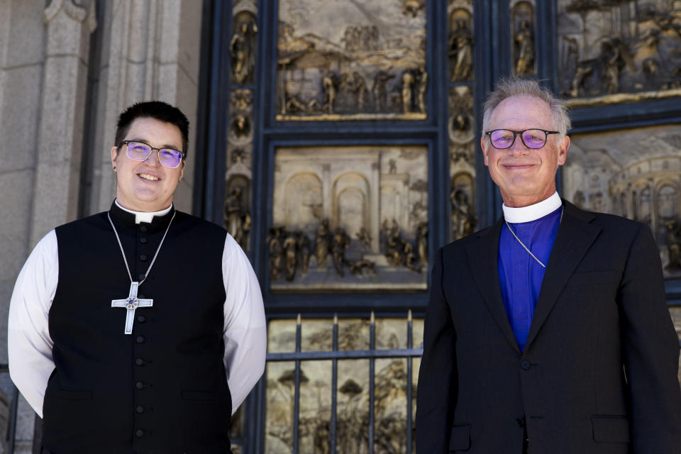 Bishops Megan Rohrer, left, and Marc Andrus pose for the media before Bishop Rohrer's installation ceremony at Grace Cathedral in San Francisco, Saturday, Sept. 11, 2021. Rohrer is the first openly transgender person elected as bishop in the Evangelical Lutheran Church of America. (AP Photo/John Hefti)