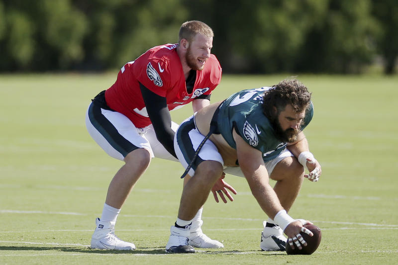 Carson Wentz practices taking a snap from center Jason Kelce.