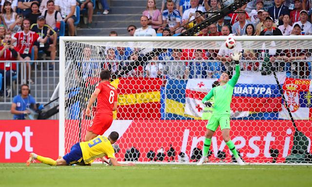 Jordan Pickford saves from Marcus Berg of Sweden in England's 2-0 win.
