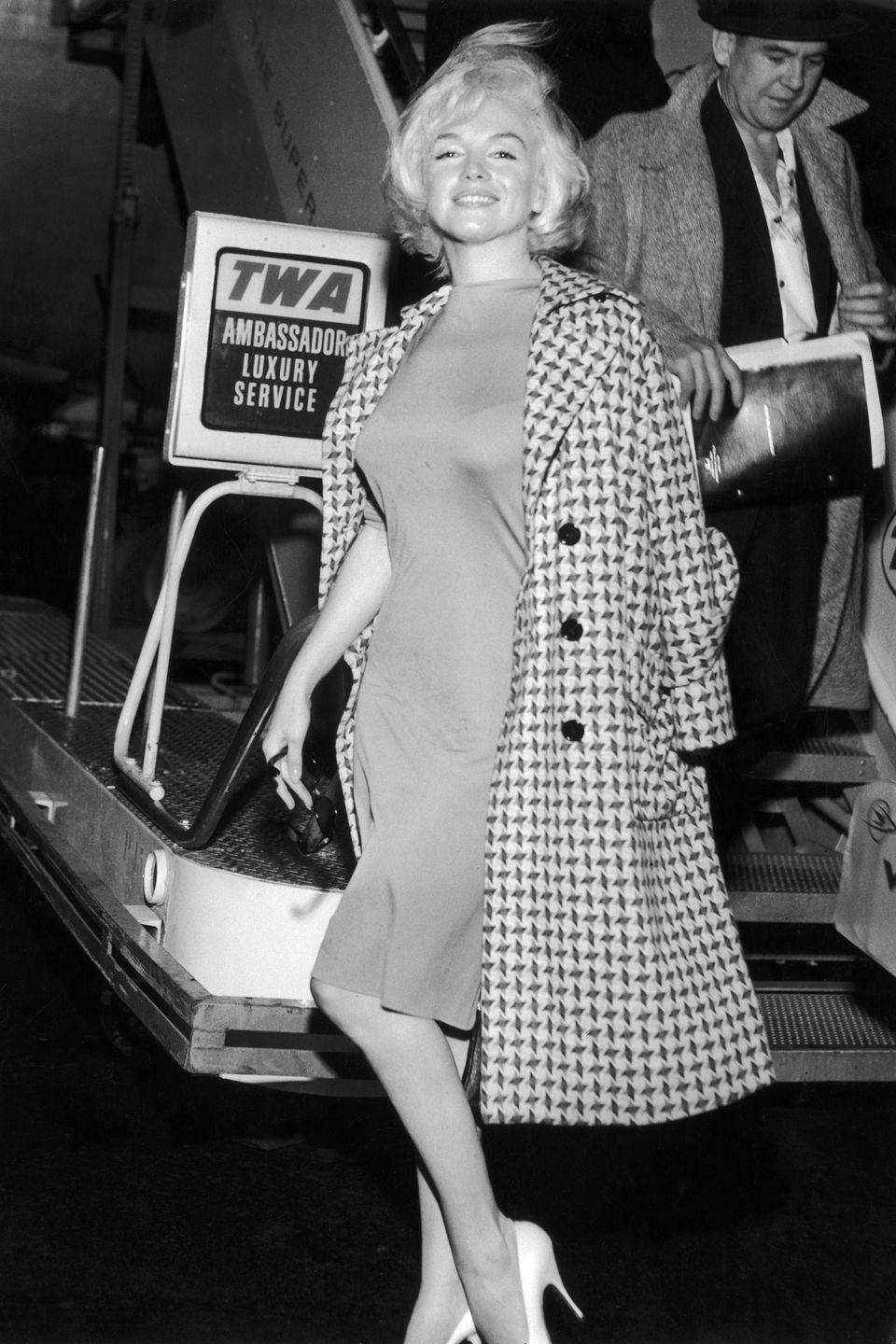 <p>Monroe arrives at New York International Airport (now LaGuardia) from Los Angeles. She died one year later in 1962. </p>