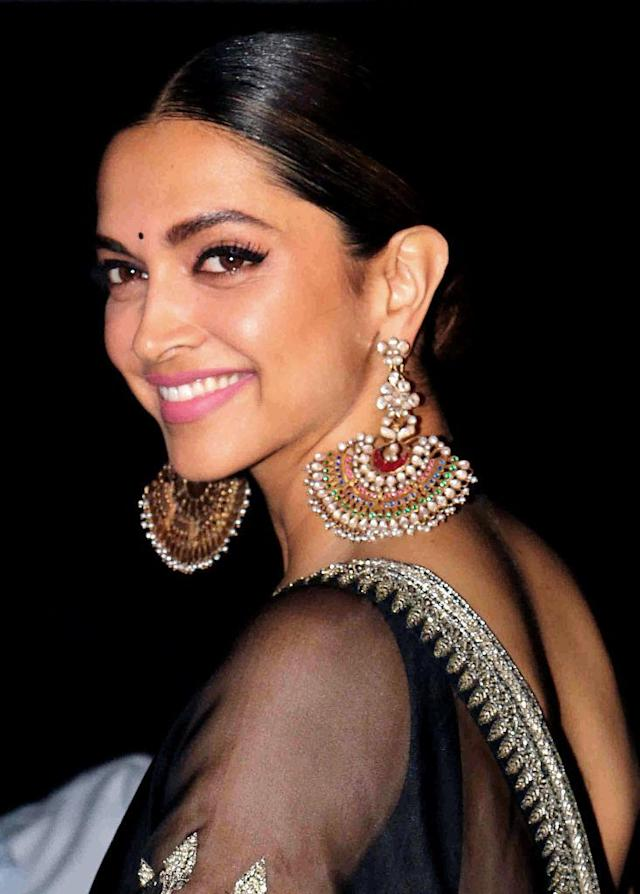 <p>The Bollywood actress paired her statement-making earrings with mascara, winged eyeliner, and a swipe of bubblegum-pink lipstick. (Photo: Getty Images) </p>