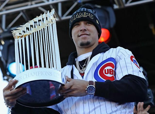 Javier Baez shows off the spoils of victory, the World Series trophy during the Cubs' championship parade. (Getty)