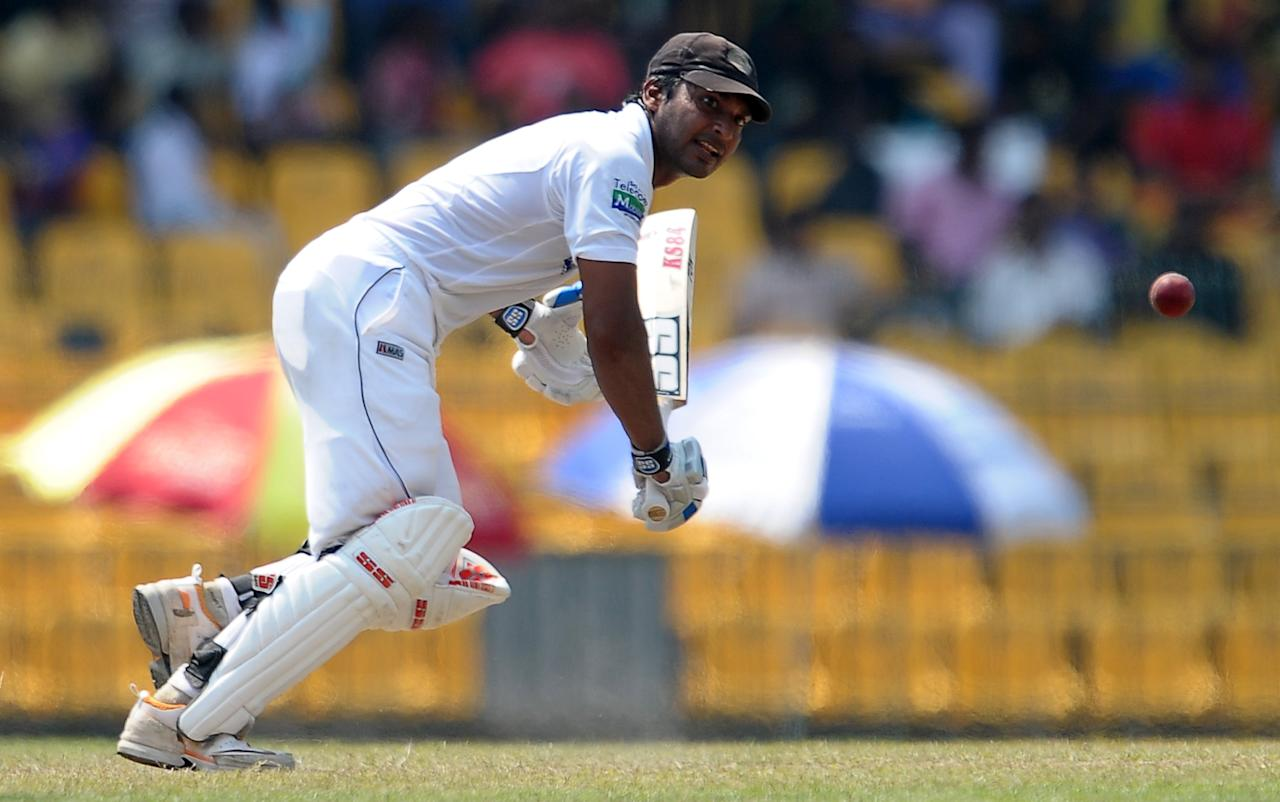 Sri Lanka's cricketer Kumar Sangakkara plays a shot  during the second day of their second Test match between Sri Lanka and Bangladesh at the R. Premadasa Cricket Stadium in Colombo on March 17, 2013. AFP PHOTO/ LAKRUWAN WANNIARACHCHI