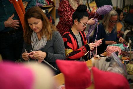 Knitters take part in the Pussyhat social media campaign to provide pink hats for protesters in the women's march in Washington, D.C., the day after the presidential inauguration, in Los Angeles, California, U.S., January 13, 2017. REUTERS/Lucy Nicholson