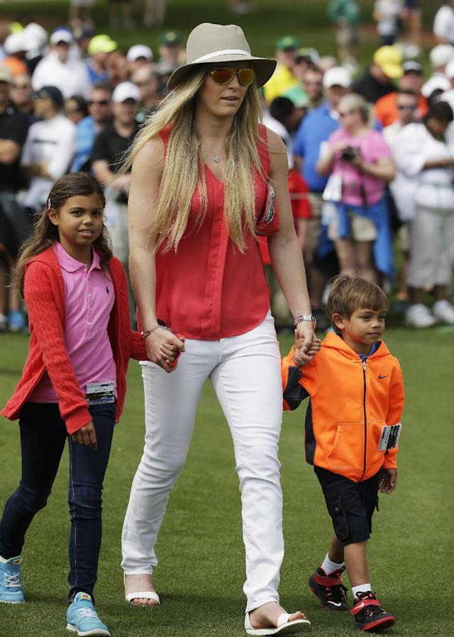 Lindsey Vonn walks with Tiger Woods' children Charlie, right, and Sam during a practice round for the Masters golf tournament Tuesday, April 7, 2015, in Augusta, Ga. (AP Photo/Chris Carlson)