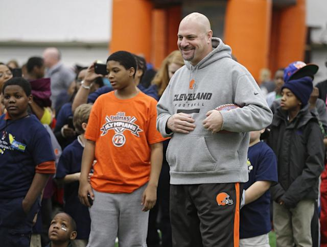 Cleveland Browns head coach Mike Pettine meets area Special Olympians at the NFL team's Play 60 football festival at their practice facility in Berea, Ohio, Thursday, Feb. 13, 2014. Pettine replaced Mike Chudzinski who was fired after the 2013 season. (AP Photo/Mark Duncan)