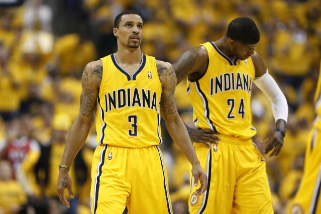 INDIANAPOLIS, IN - MAY 3: George Hill #3 and Paul George #24 of the Indiana Pacers react against the Atlanta Hawks during Game Seven of the Eastern Conference Quarterfinals of the 2014 NBA Playoffs on May 3, 2014 at Bankers Life Fieldhouse in Indianapolis, Indiana. NOTE TO USER: User expressly acknowledges and agrees that, by downloading and or using this photograph, User is consenting to the terms and conditions of the Getty Images License Agreement. (Photo by Joe Robbins/Getty Images)
