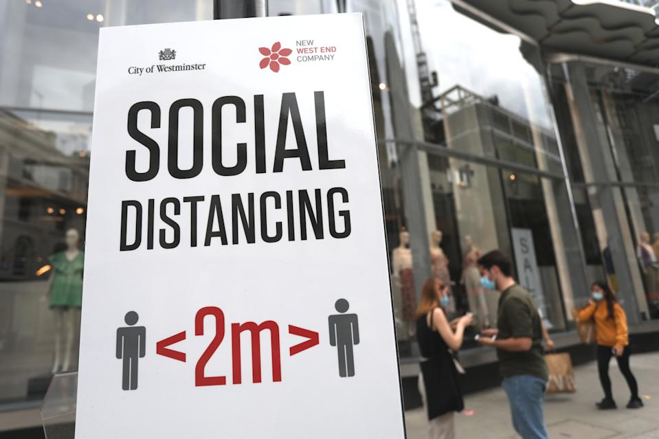 A social distancing sign telling shoppers to adhere to social distancing and stay two metres apart on Oxford Street, London, as non-essential shops in England open their doors to customers for the first time since coronavirus lockdown restrictions were imposed in March. Picture date: Monday June 15, 2020.