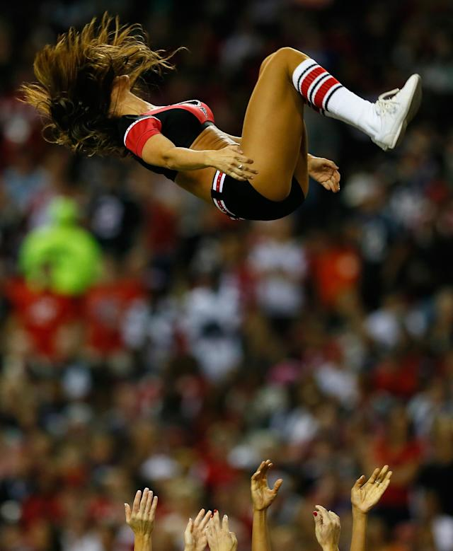 ATLANTA, GA - SEPTEMBER 29: An Atlanta Falcons cheerleader is tossed in the air during the game against the New England Patriots at Georgia Dome on September 29, 2013 in Atlanta, Georgia. (Photo by Kevin C. Cox/Getty Images)