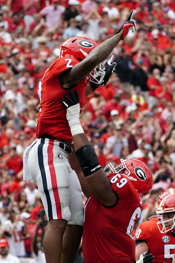 Georgia running back Zamir White (3) celebrates with Jamaree Salyer (69) after recovering a blocked punt in the end zone for a touchdown during the first half of an NCAA college football game against Arkansas Saturday, Oct. 2, 2021, in Athens, Ga.. (AP Photo/John Bazemore)