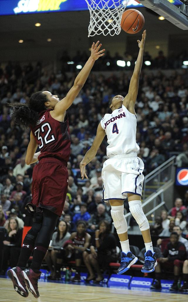 Connecticut's Moriah Jefferson (4) drives past Temple's Natasha Thames (32) during the second half of Connecticut's 80-36 victory in an NCAA college basketball game in Bridgeport, Conn., Saturday, Jan. 11, 2014. (AP Photo/Fred Beckham)