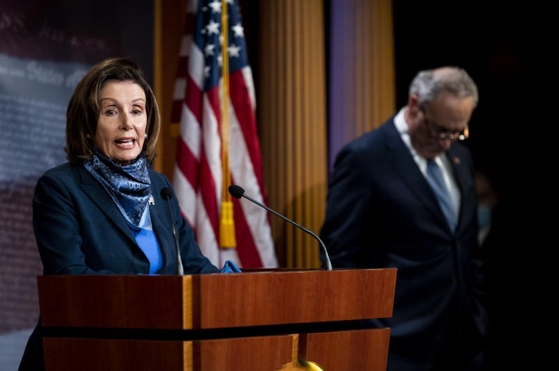 UNITED STATES - APRIL 21: Speaker of the House Nancy Pelosi, D-Calif.,and Senate Minority Leader Chuck Schumer, D-N.Y., hold a socially distanced press conference in the Capitol after the Senate passed coronavirus relief during a pro forma session on Tuesday, April 21, 2020. The Senate passed a $483.4 billion economic relief measure Tuesday that would replenish a popular small-business loan program and provide funding for hospitals facing financial shortfalls due to COVID-19.(Photo By Bill Clark/CQ-Roll Call, Inc via Getty Images)