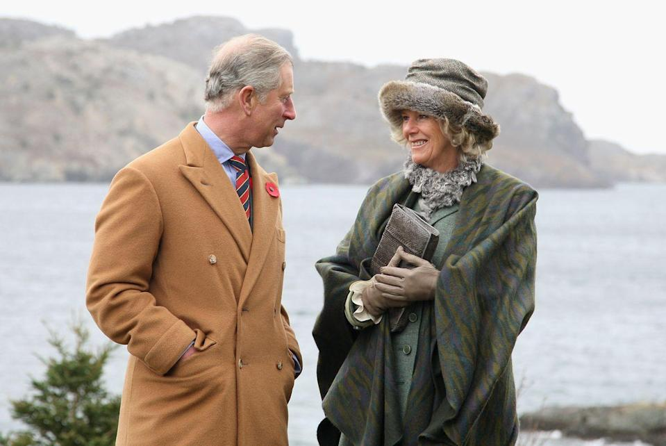 <p>The Duchess and the Prince bundled up and posed for a photograph in the historic town of Brigus during their tour of Canada.</p>
