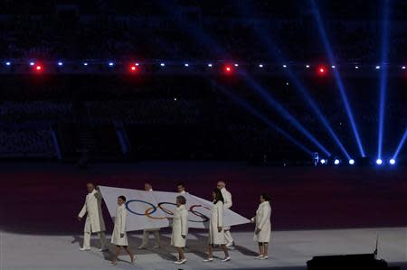 The Olympic flag is carried into the stadium during the opening ceremony of the 2014 Sochi Winter Olympics, February 7, 2014. REUTERS/Phil Noble