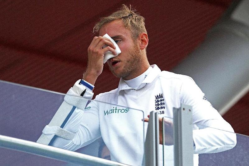 England's Stuart Broad leaves the field after sustaining an injury during the third day of the fourth cricket Test match between England and India at Old Trafford in Manchester on August 9, 2014