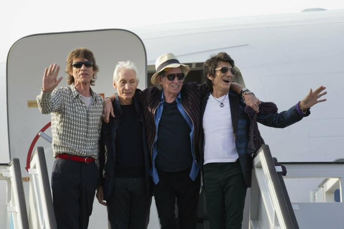 FILE - Members of The Rolling Stones, from left, Mick Jagger, Charlie Watts, Keith Richards and Ron Wood pose for photos from their plan at Jose Marti international airport in Havana, Cuba on March 24, 2016. Watts' publicist, Bernard Doherty, said Watts passed away peacefully in a London hospital surrounded by his family on Tuesday, Aug. 24, 2021. He was 80. (AP Photo/Ramon Espinosa File)