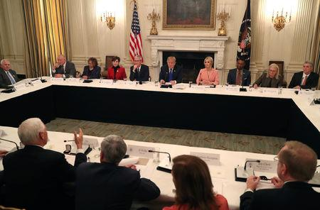 U.S. President Donald Trump participates in an American Workforce Policy Advisory Board meeting in the White House State Dining Room in Washington, U.S., March 6, 2019. REUTERS/Leah Millis