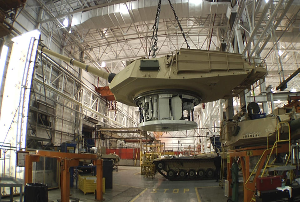FILE - This undated file photo provided by the General Dynamics Land System shows the production of an Abrams tank in Lima, Ohio. Lawmakers from both parties have devoted nearly half a billion dollars in taxpayer money over the past two years to build improved versions of the 70-ton Abrams, which the Army refers to with a moniker that befits their heft: the M1A2SEPv2. The upgraded tanks cost about $7.5 million each, according to the Army, and service officials say they have plenty of them. (AP Photo/General Dynamics Land System, File)